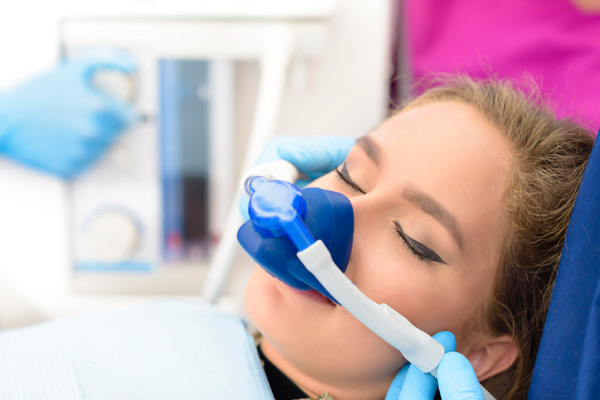 Sedated woman in dental chair receiving treatment at Eastside Dental Clinic in Troutdale, OR